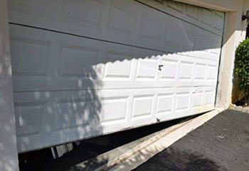 Garage Door Off Track Next To Plantation FL